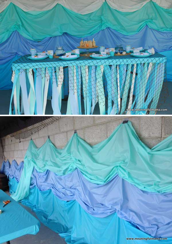 Make This Easy Under The Sea Backdrop Using Plastic Tablecloths