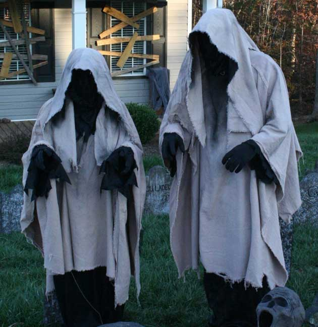 "#22. Some black material under the drop cloths create the effect of the  faceless ghosts ""floating"" in low light. - 46 Successful DIY Outdoor Halloween Decorating Ideas Nobody Told You"