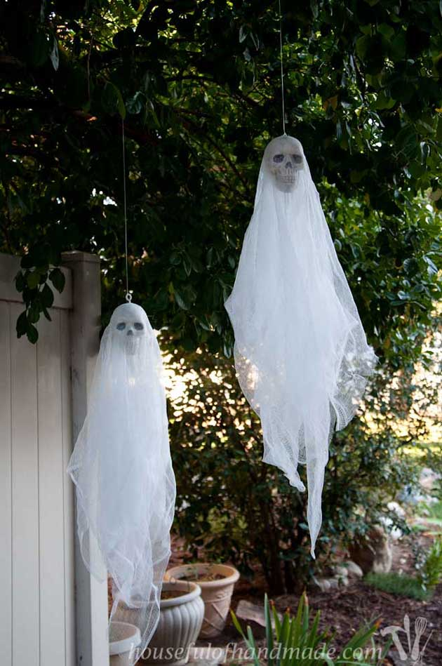 hang skull ghosts from your front porch to spooky up your halloween visitors