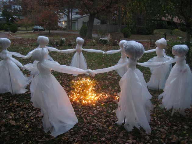 #46. Transform some cheap plastic drop cloths into these creepy ghosts. - 46 Successful DIY Outdoor Halloween Decorating Ideas Nobody Told You